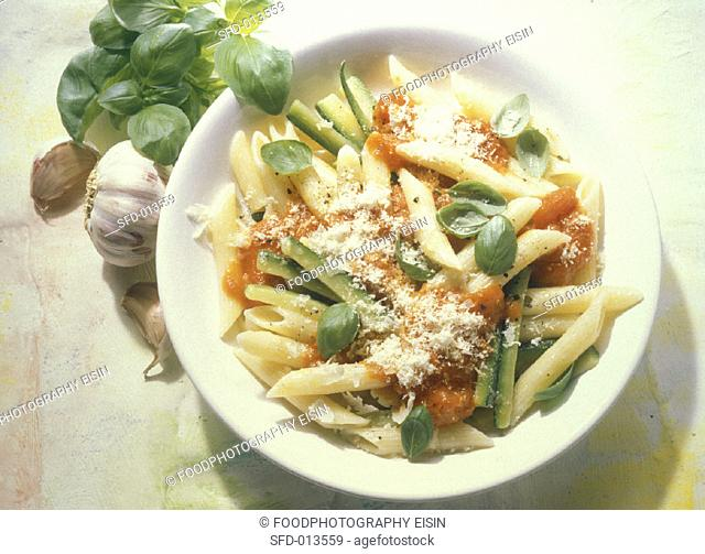 Penne with courgettes and tomato sauce