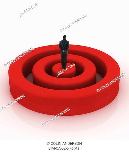 Businessman standing on bullseye