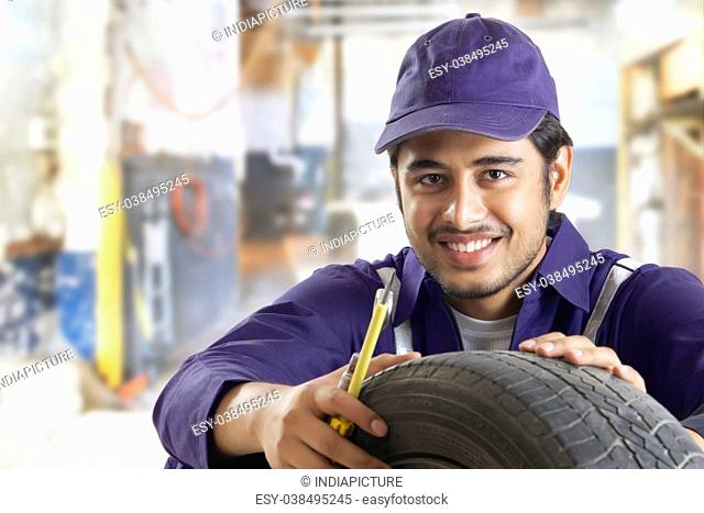 Portrait of car mechanic in repair garage