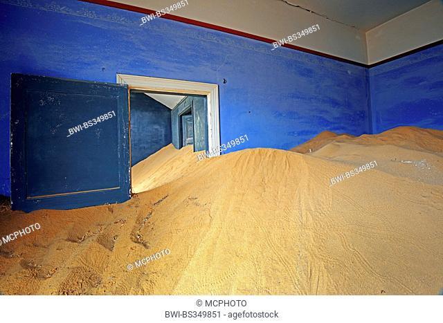house taken from dunes and desert sand, buidling of the former village Kolmanskop at a diamond mine, Namibia, Kolmanskop