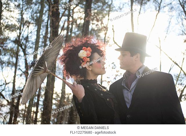 Couple dressed in gothic theme for their engagement portrait; Pittsboro, North Carolina, USA