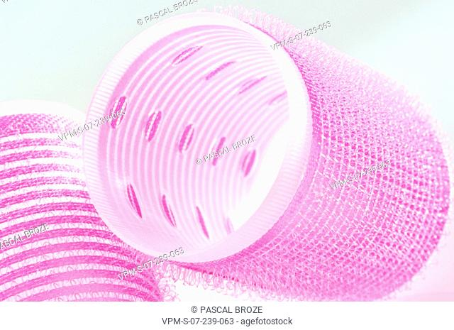 Close-up of two pink hair curlers