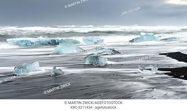 Icebergs on black volcanic beach. Beach of the north atlantic near the glacial lagoon Joekulsarlon and glacier Breithamerkurjoekull in the Vatnajoekull NP