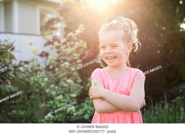 Smiling girl in garden