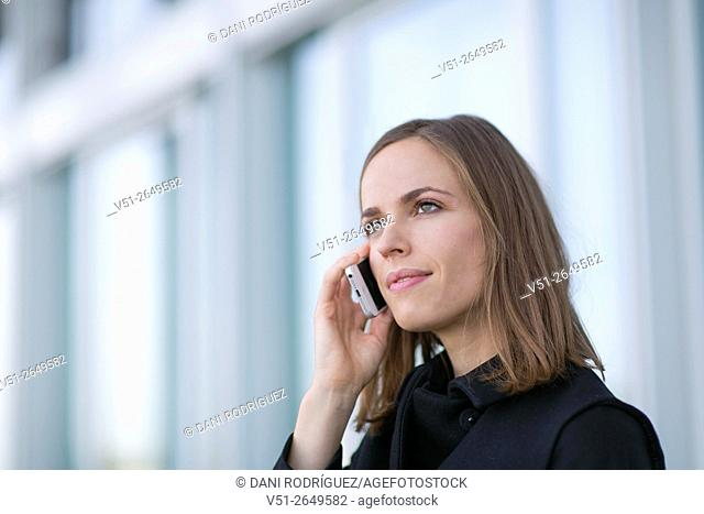 Pretty woman making a call outdorrs
