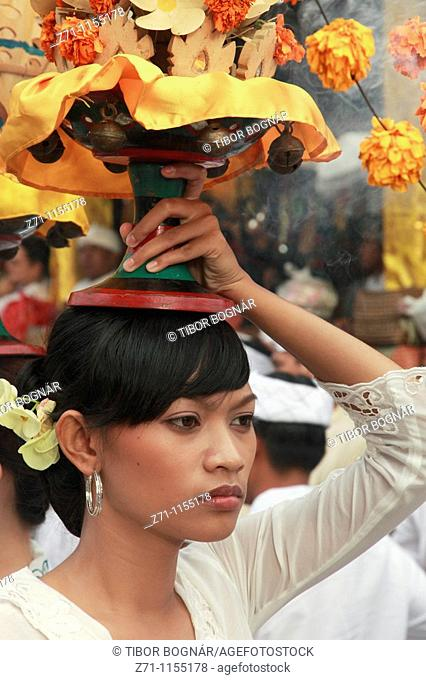 Indonesia, Bali, Mas, temple festival, woman carrying offerings, odalan, Kuningan holiday