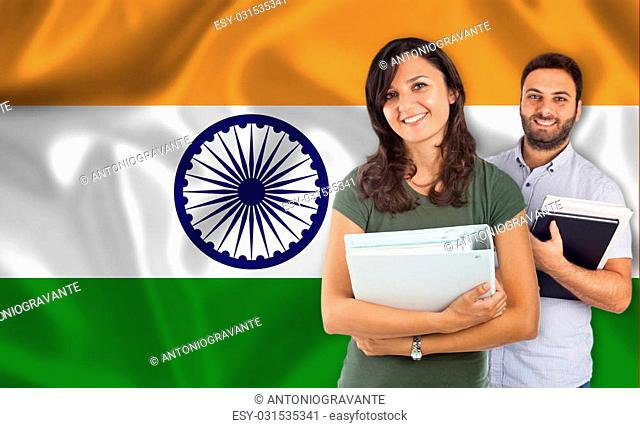 Couple of young students with books over indian flag