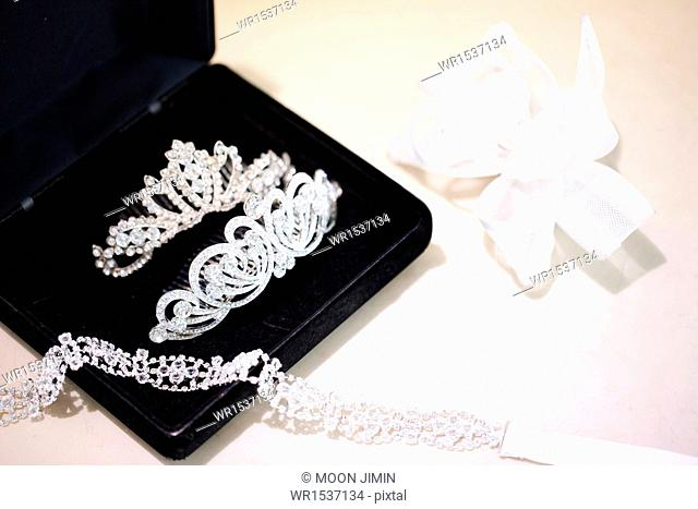 wedding accessories in a black box