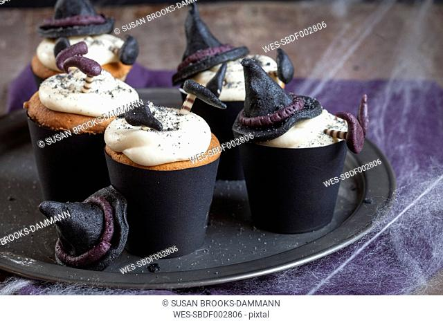 Halloween cupcakes with crashed witches topping