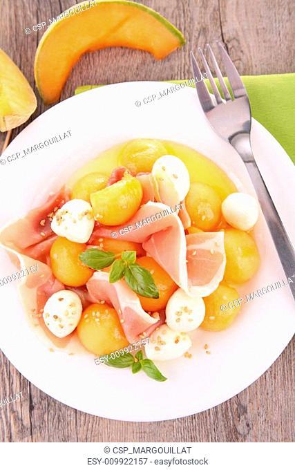 salad with melon,mozzarella and prosciutto