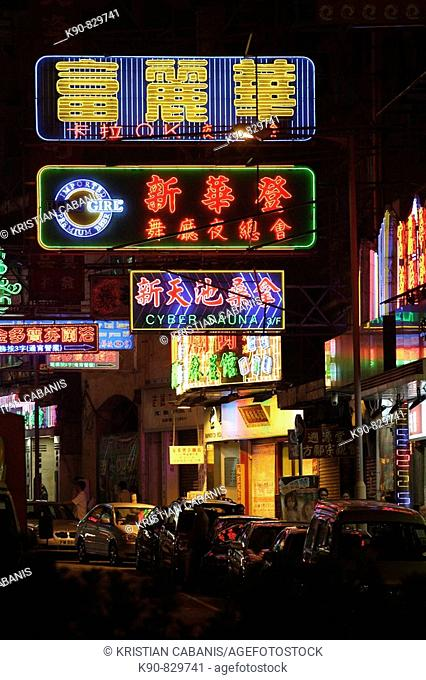 Colorful neon lights of bars and restaurant in small side street in Kowloon, Hong Kong, China, Southeast Asia