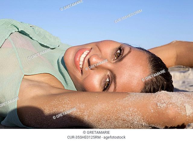Woman in bikini laying on beach