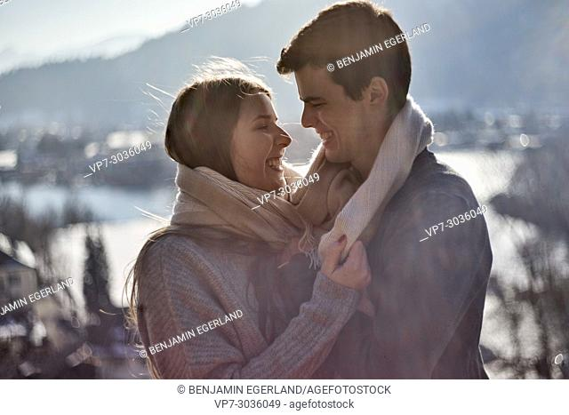 happy couple embracing each other. German ethnicity. Winter time. At Tegernsee, Germany