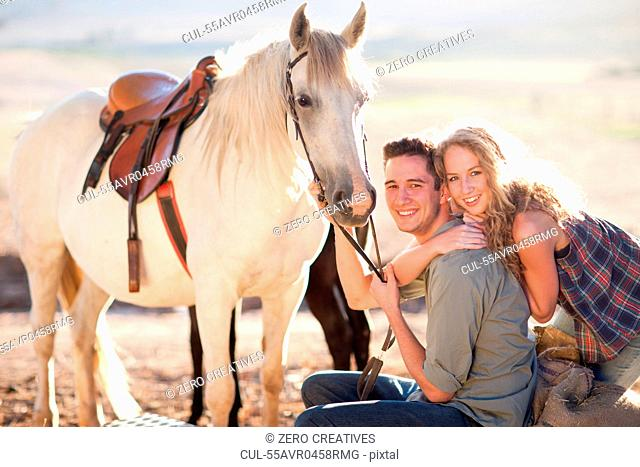 Young couple with horse