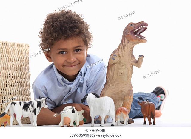 Young boy with his toy animals