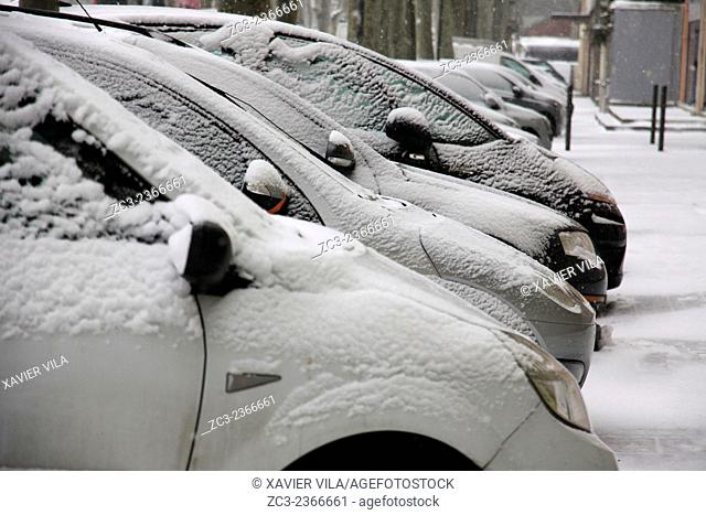 Cars - Grenoble city center in winter under the snow. Dauphine Alps, Isere, Rhone Alpes, France. Grenoble, FRANCE