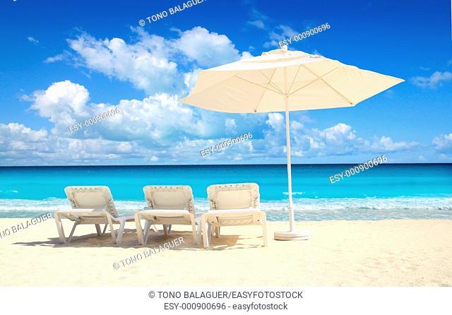 Caribbean beach parasol white umbrella and hammocks turquoise sea