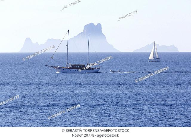 View of Es Vedra island and yachts from Formentera, Balearic Islands, Spain