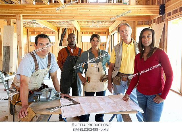 Construction workers in unfinished room