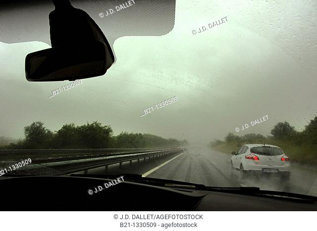 On the highway Bordeaux Lyon driving under rain, Gironde, Aquitaine, France