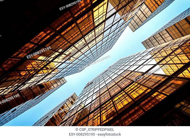 Upwards shot of Hong Kong office buildings reflecting light