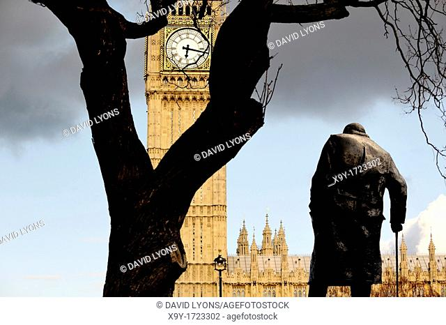 Statue of Sir Winston Churchill in Parliament Square faces Big Ben clock tower and the Houses of Parliament, London