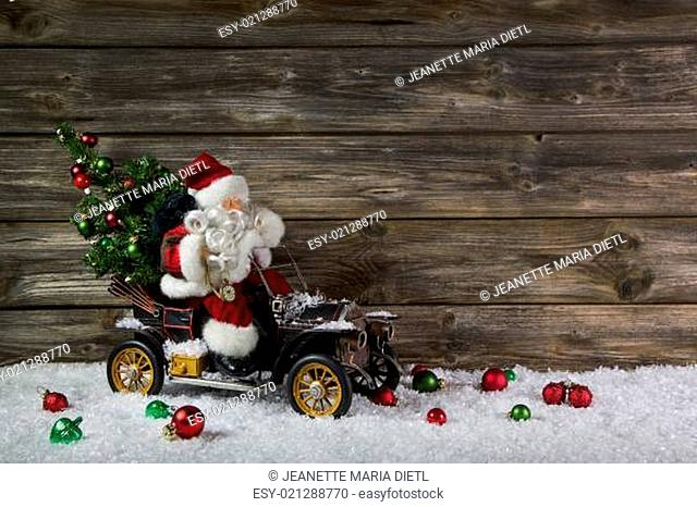 Funny wooden christmas background with santa for a voucher or coupon