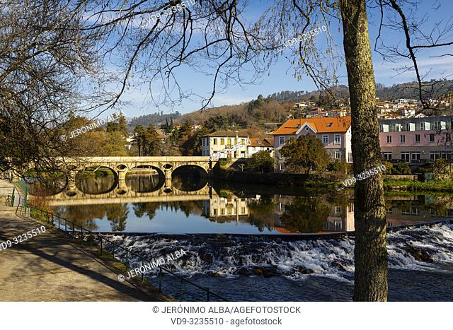 Ancient bridge, Vez river and village of Arcos de Valdevez. Viana do Castelo, Alto Minho region. Northern Portugal, Europe