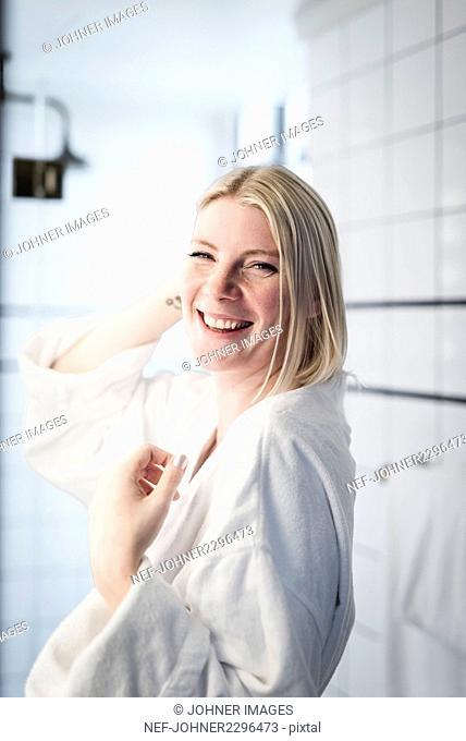 Happy blond woman in bathroom