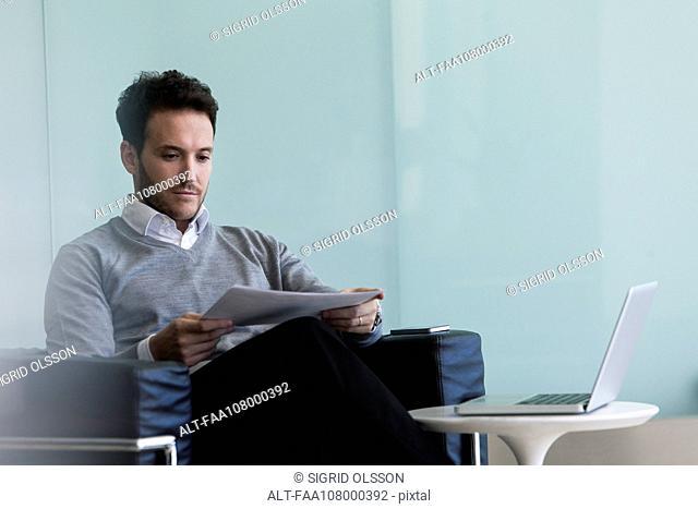 Businessman reviewing report