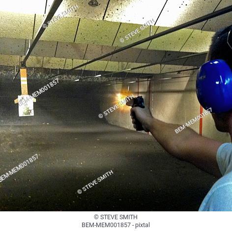 Man shooting gun in range