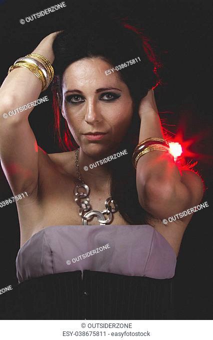 Red light, woman with Venetian mask metal, sad and pensive