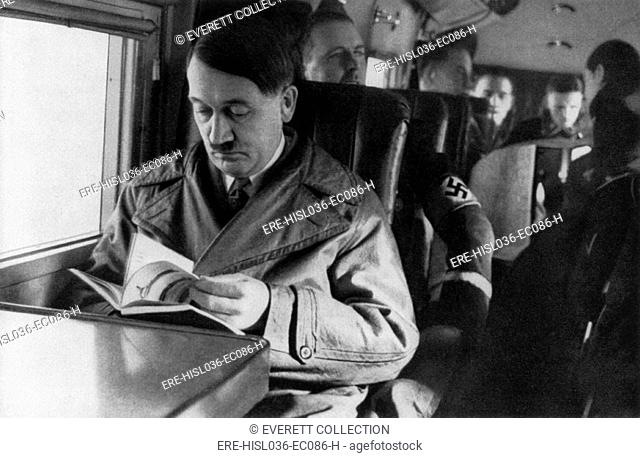 Adolf Hitler reading in airplane, ca. 1940. (BSLOC-2013-9-167)