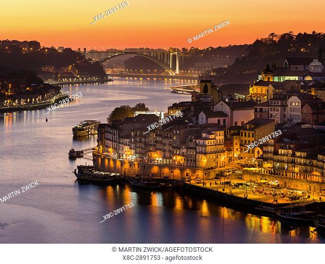 Sunset over Rio Douro. Left Vila Nova de Gaia, right the old town. City Porto (Oporto) at Rio Douro in the north of Portugal