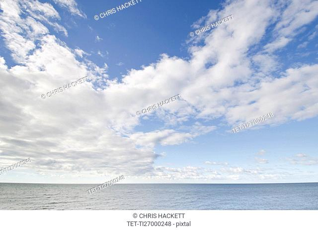 Seascape and cloudy sky