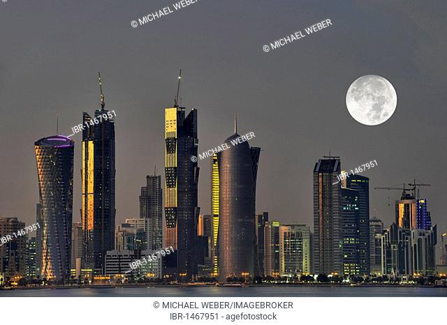 Twilight shot, Doha skyline with the Tornado Tower, Navigation Tower, Peace Towera, Al-Thani Tower and the moon, Doha, Qatar, Persian Gulf, Middle East, Asia
