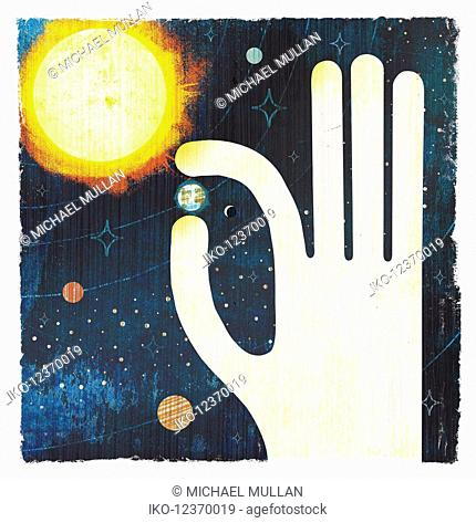 Large hand picking planet earth in solar system