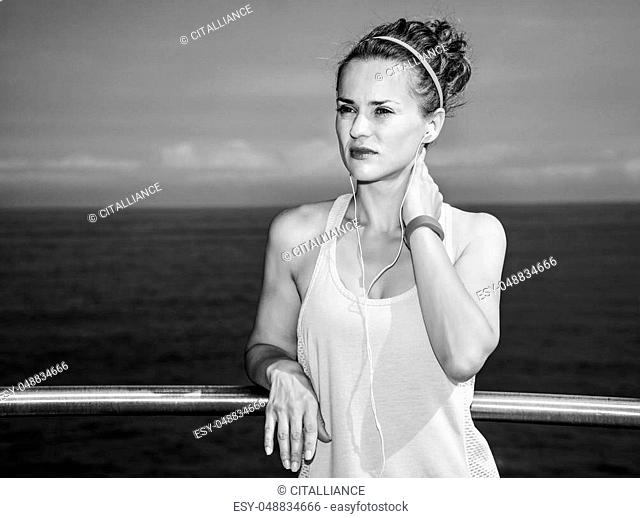 Look Good, Feel great! Portrait of young healthy woman in fitness outfit looking into the distance at the embankment