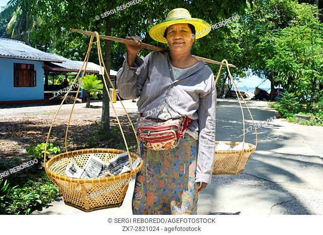 Woman fish peddler. Fishing gypsy village. Koh Mook (Muk) is a small rocky island off the coast of Trang province. On the east side