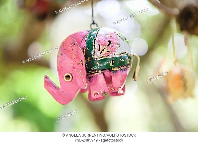 Garden decoration of metal representing animals hanging down a tree
