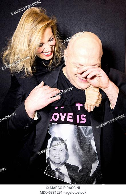 The singer-songwriter Grazia Di Michele hugging the TV star Platinette (Maurizio Coruzzi). Milan, Italy. 15th January 2015