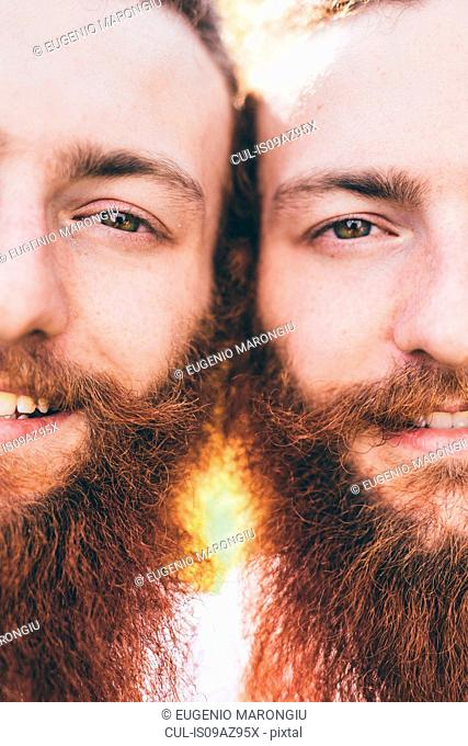 Cropped close up portrait of young male hipster twins with red beards