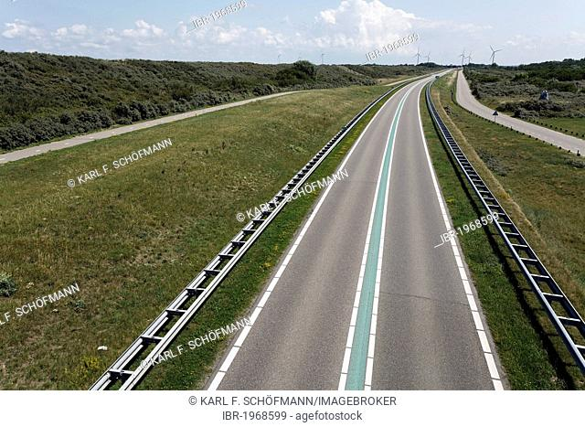 Street with a green median strip, traffic free, Veerse Dam between Walcheren and Noord-Beveland, Zeeland, Netherlands, Europe