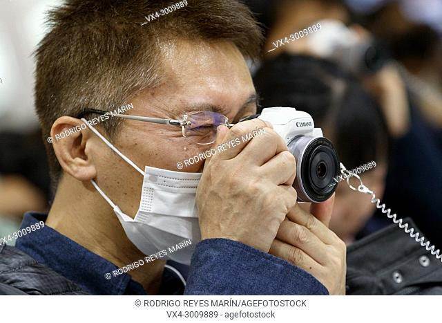 March 3, 2018, Yokohama, Japan - A man tries out the new Canon camera EOS Kiss M at the CP+ Camera & Photo Imaging Show 2018 in Pacifico Yokohama