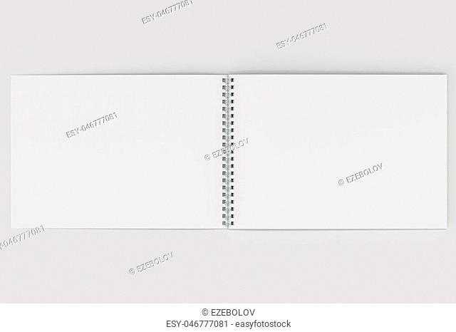 Open blank white notebook with metal spiral bound on white background. Business or education mockup. 3D rendering illustration