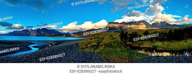 Sunrise in Patagonian Andes, big size panorama. Small river near Viedma lake, Los Glaciares national park
