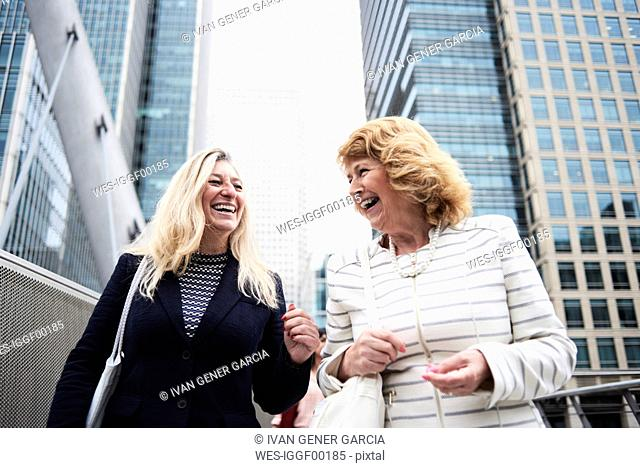 UK, London, two happy senior businesswomen in the city
