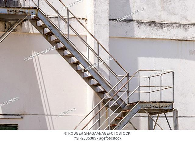 Outdoor steel fire escape attached to the side of a building