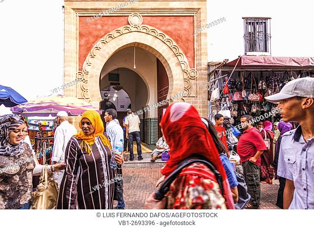 Women and mosque at a souk in Rabat, Morocco