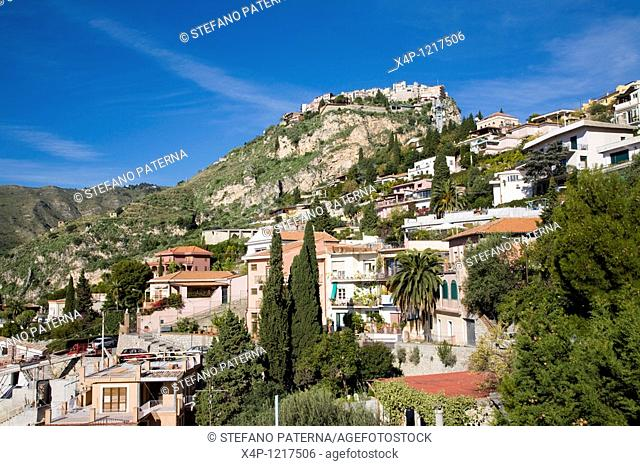 Roofs of Taormina and the village of Castelmola on top of the hill  View from Taormina, Sicily, Italy